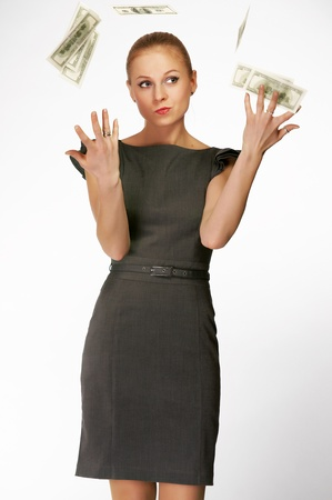 Office girl with dollars in hands