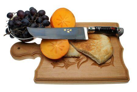 The Uzbek knife on a chopping board Stock Photo - 13350927