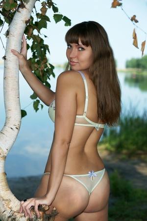 near: The beautiful girl near birches