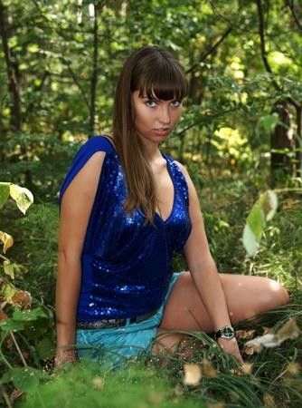 The beautiful girl in autumn wood Stock Photo - 13352297