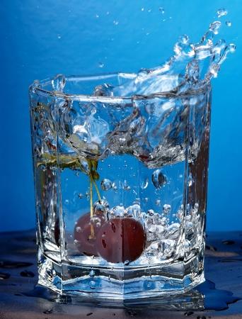 cherry splashed into water Stock Photo - 13402013