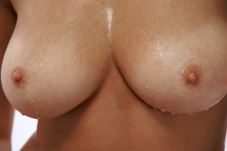 Close up of wet female breast