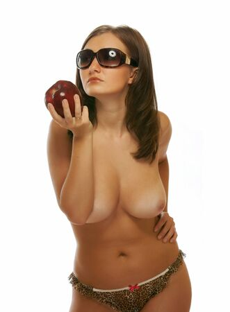 A nude girl with dark glasses holding an apple Stock Photo - 13401988