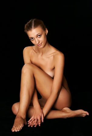 nude girl on a black background