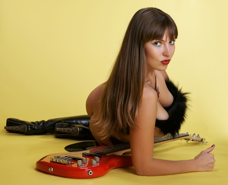 A nude girl with a guitar