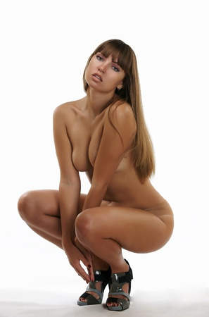 Nude girl on a white background