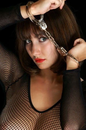 The sexual girl with handcuffs Stock Photo - 13408432
