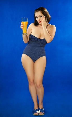 The girl in a bathing suit with orange juice photo
