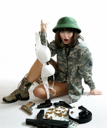 The sexy girl in the military form photo