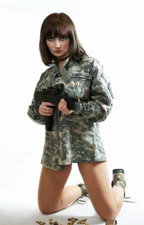 stocking cap: The sexy girl in the military form Stock Photo