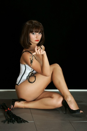 The sexual girl with handcuffs Stock Photo - 13403038