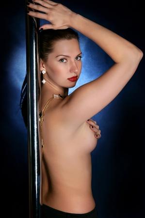 The girl dances a striptease Stock Photo