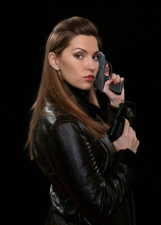 The girl with the weapon Stock Photo