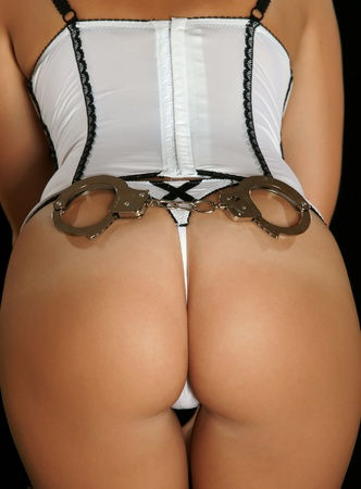 Sexy girl with handcuffs Stock Photo - 13408230