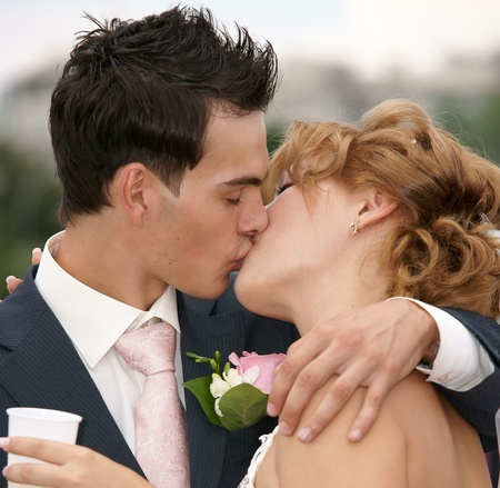 Kiss of the groom and the bride