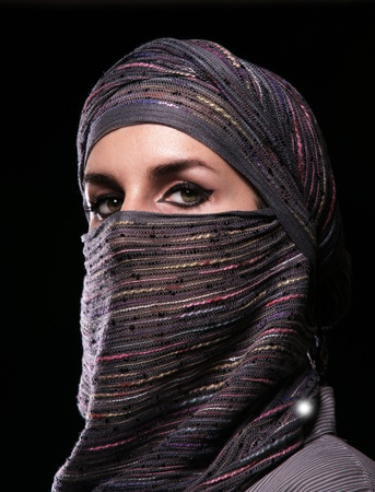 Portrait of a girl in middle eastern clothes. photo
