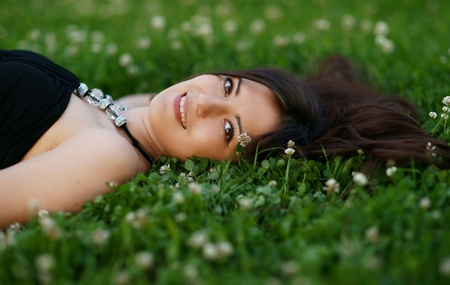 The beautiful girl on a green grass Stock Photo - 13412599