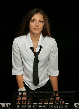 The girl and a synthesizer photo