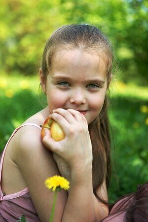 The little girl with an apple photo