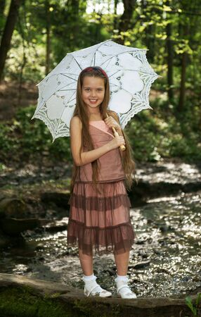 child girl nude: The little girl with an umbrella Stock Photo