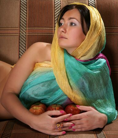 The girl in a scarf with apples Stock Photo - 13414946