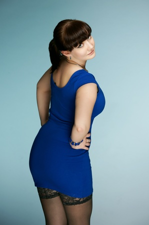 The beautiful brunette in a dark blue dress Stock Photo - 13411747