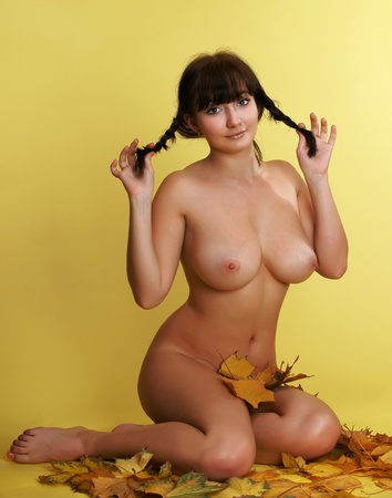 A nude girl on maple leaves