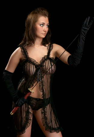 bared: A girl in sexy lingerie with the Japanese sword Stock Photo
