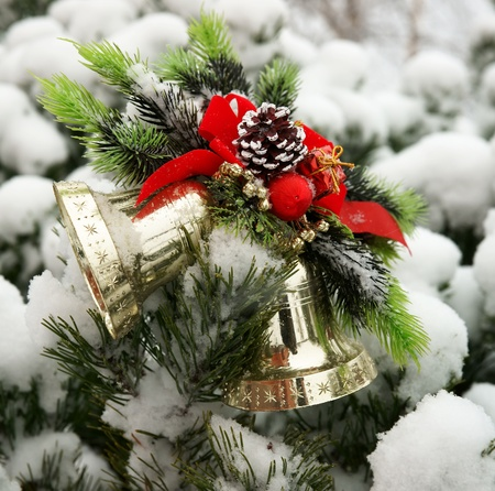 Christmas hand bells on a fur-tree photo
