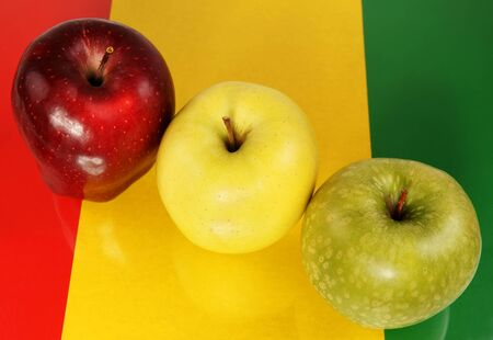 Three multi-coloured apples Stock Photo - 13417576