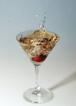 Cherry in a glass with champagne photo