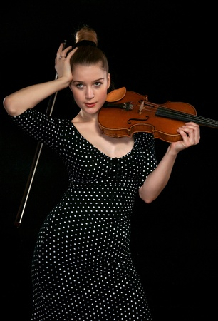 Girl holding a violin photo