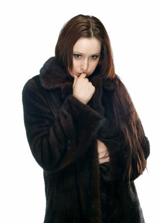 de trieste meisje in een bontjas Stockfoto