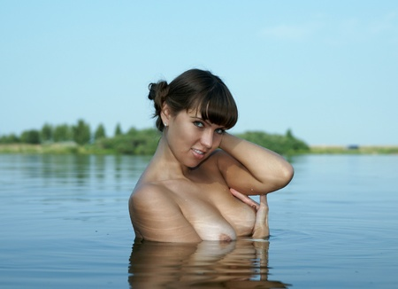 A nude girl bathes in lake Stock Photo - 13417298
