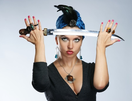 The girl in a turban with a dagger photo
