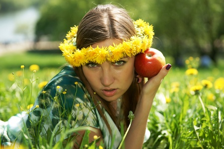 The beautiful girl with an apple Stock Photo - 13418352