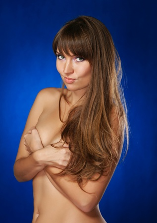 The cheerful nude girl on a dark blue background photo