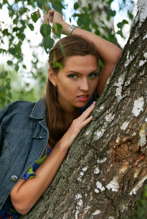 The beautiful girl near birch trees photo