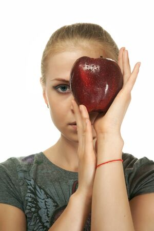 The blonde with an apple on a white background photo