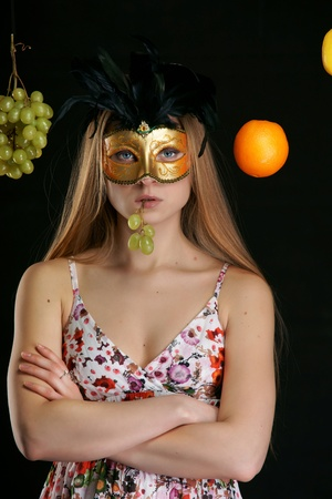 The girl in a mask with fruit photo