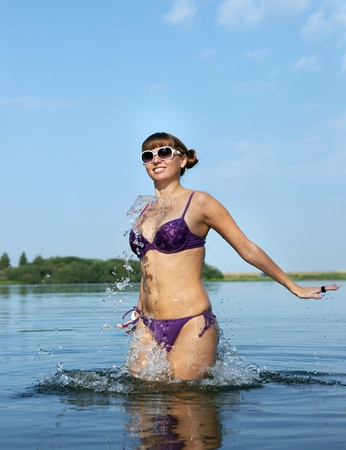 The girl in bikini in lake  photo