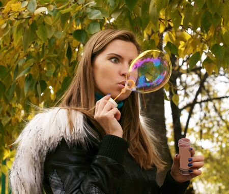 The girl and a soap bubble. photo