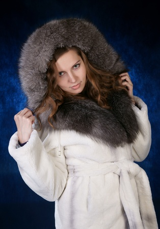The girl in a fur fur coat photo