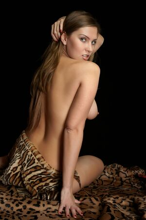 The bared girl in a leopard skin photo