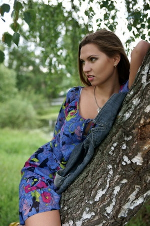 The beautiful girl near birches photo