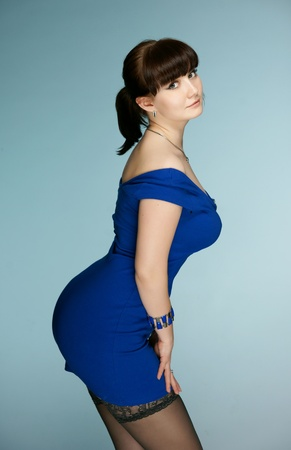 The beautiful brunette in a dark blue dress photo