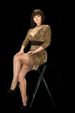 Sexy girl in leopard dress Stock Photo