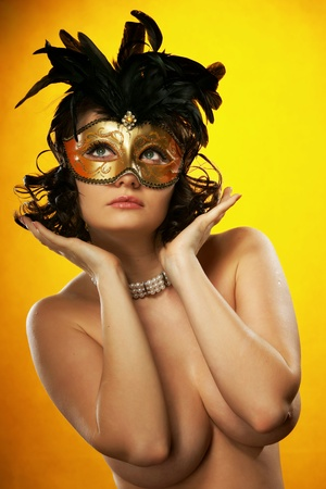 The sexy girl in a mask photo