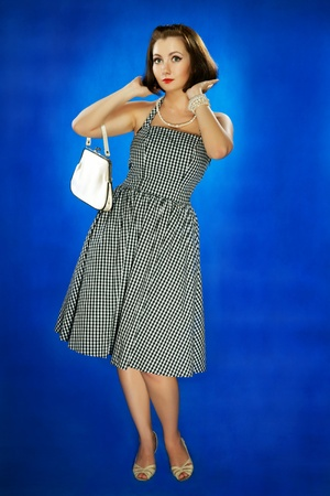 The girl in style 30 on a dark blue background Stock Photo