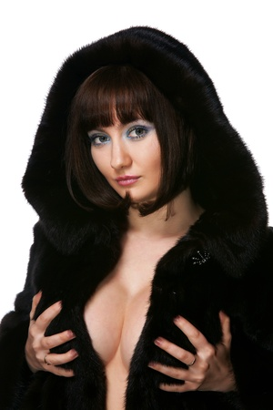 The sexy girl in a fur coat on a white background Stock Photo - 13462990